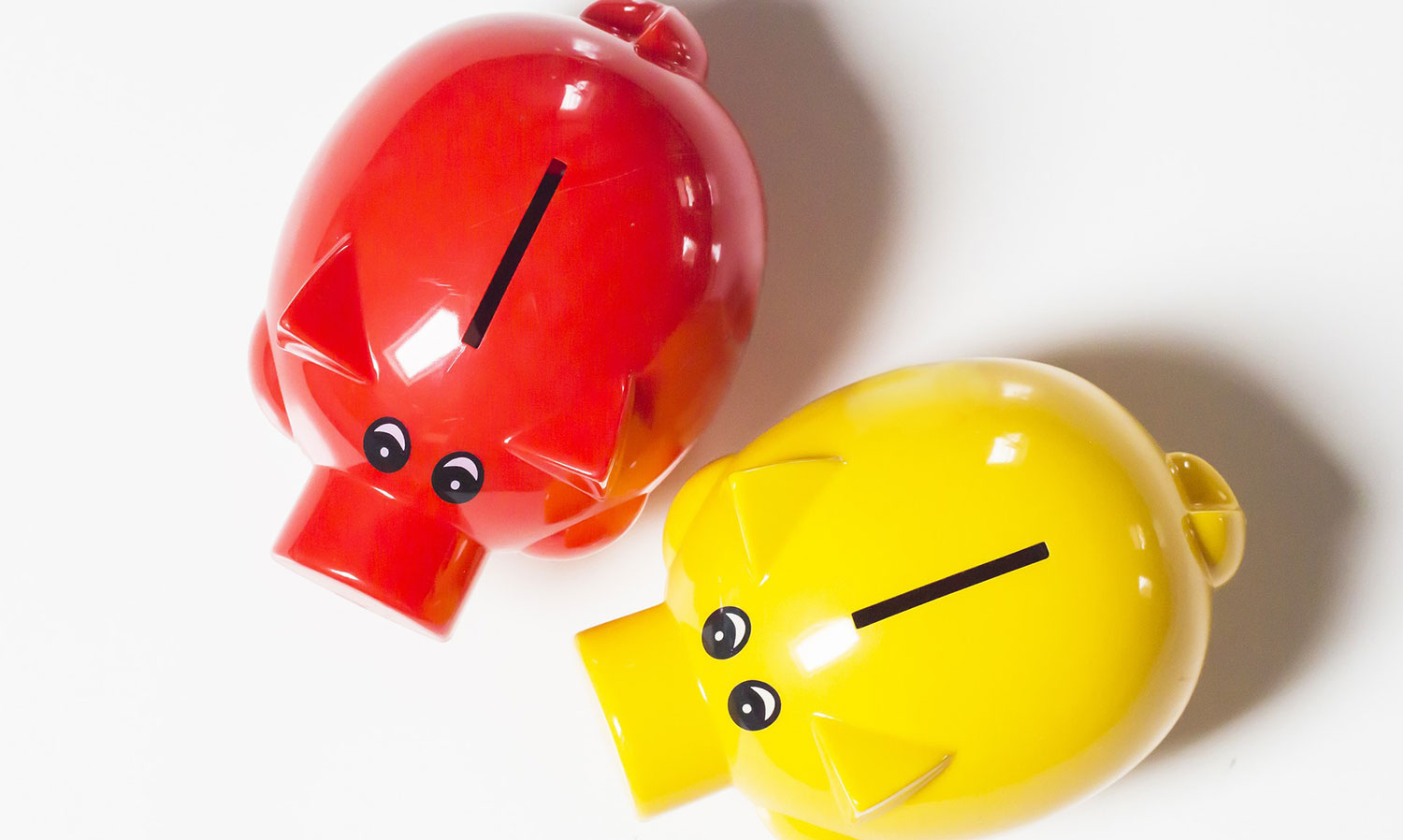 equity release - two piggy banks one red one yellow